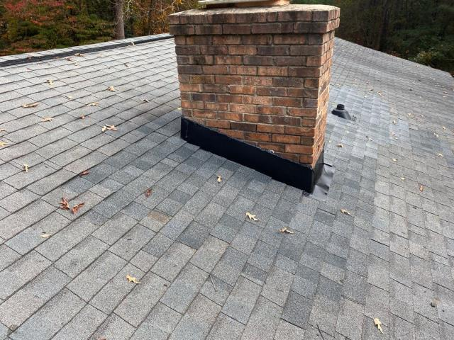 Gilbert, SC - Roof repairs completed included replacing the chimney flashing, plumbing boots and shingles with nail pops.