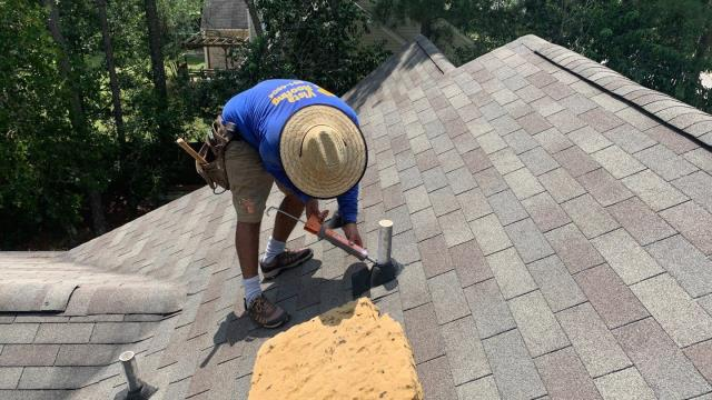 Lexington, SC - One  of Vista Roofing's expert local roofers works on a clients roof in Lexington, SC. Give us a call for a no cost roof assessment today!