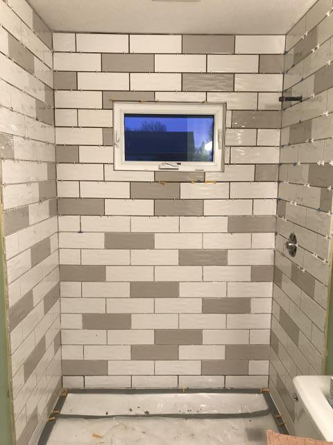 Finished laying the subway tile for the new shower surround! Grouting tomorrow!