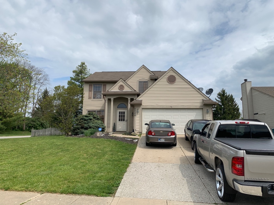 Indianapolis, IN - Providing a roofing quote after a complete free inspection.
