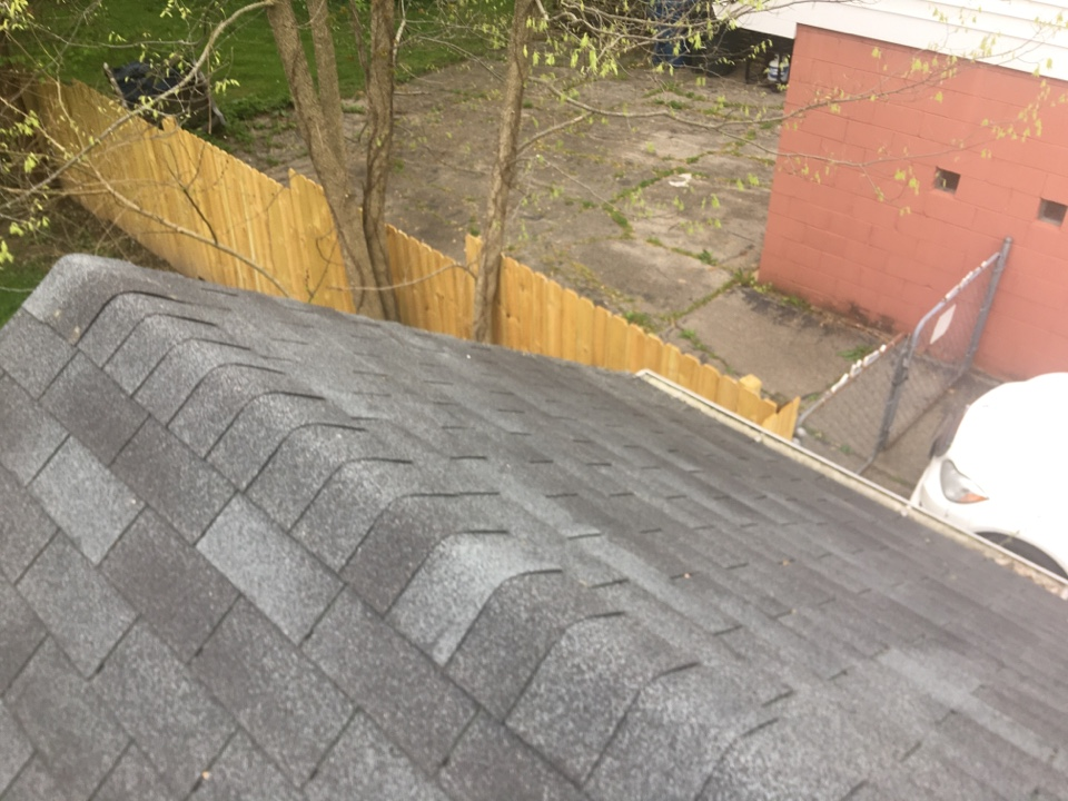 Indianapolis, IN - Inspecting roof for damage that could result in replacement or repair.