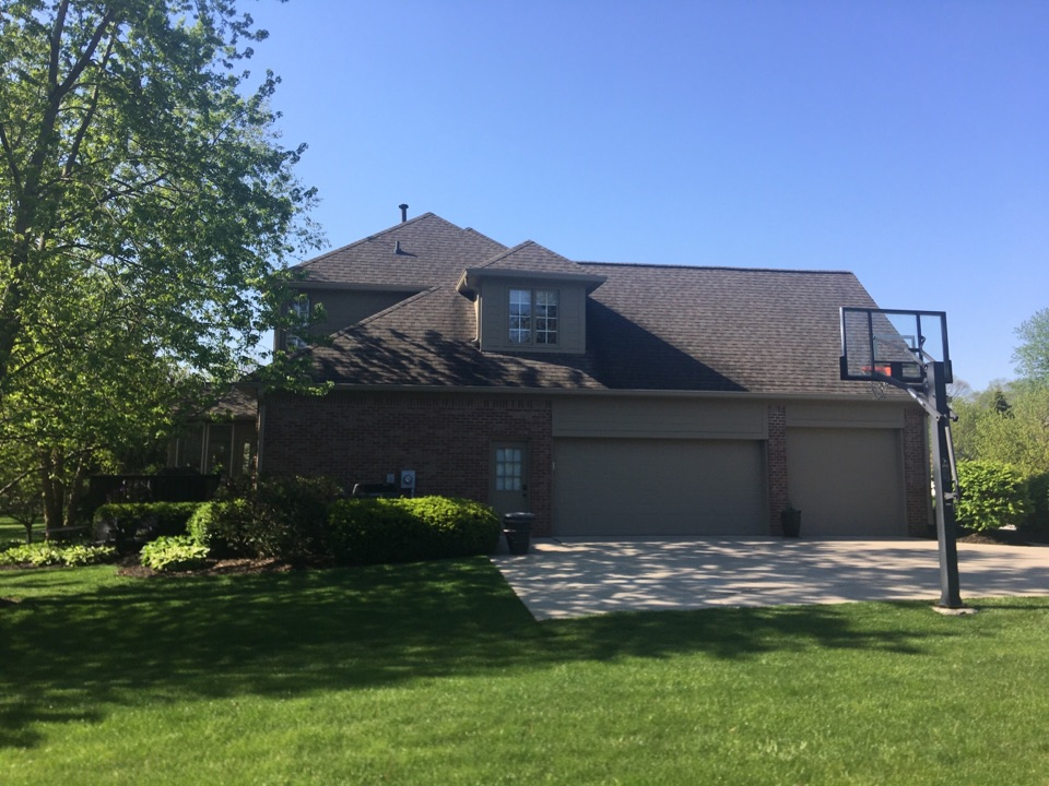 Carmel, IN - Home needs new gutters, providing a free estimate.