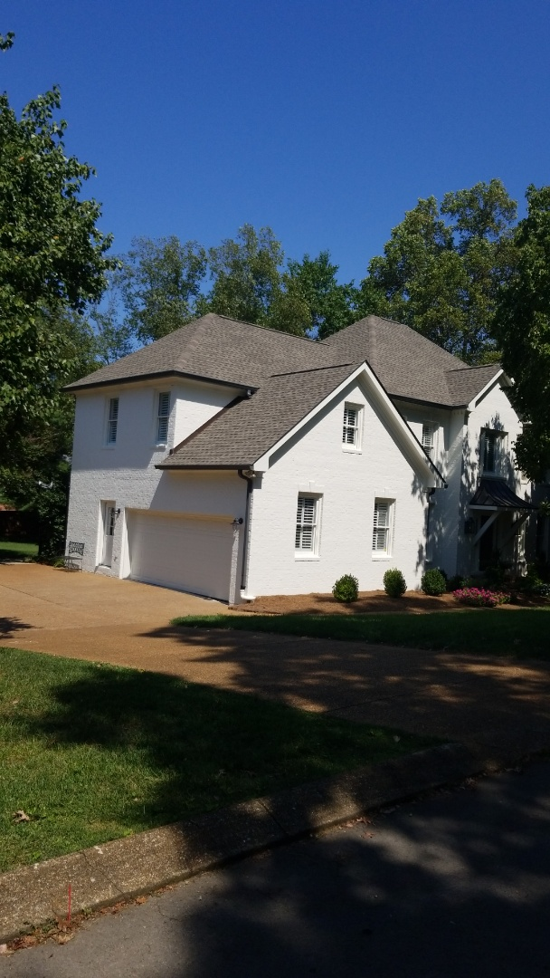 Harrison, TN - Putting gutter guards on this house