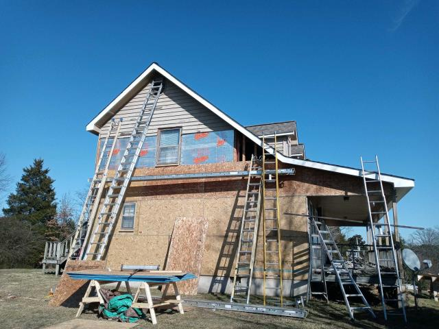Charleston, TN - Our crew is in the process of removing old, peeling siding on this Charleston, TN home. The crew is placing new fanfold insulation and moisture barriers and OSB as needed to keep this home secure for years to come. Once everything is off and prepped, beautiful new Royal Building Products Market Square Vinyl Siding In DL4.5 Color - MOCHA will go up around the house. Check back soon for updated pictures once completed!