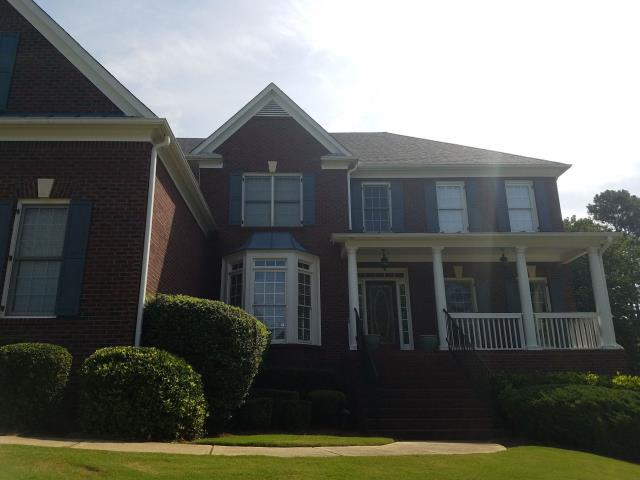 Suwanee, GA - Starting a roof in Suwanee, GA. Wind damage and needs a full replacement, using Timberline HD shingles.