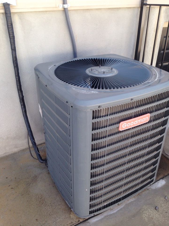 Woods Cross, UT - Annual maintenance in goodman air conditioner, using $70-off seasonal special postcard coupon.