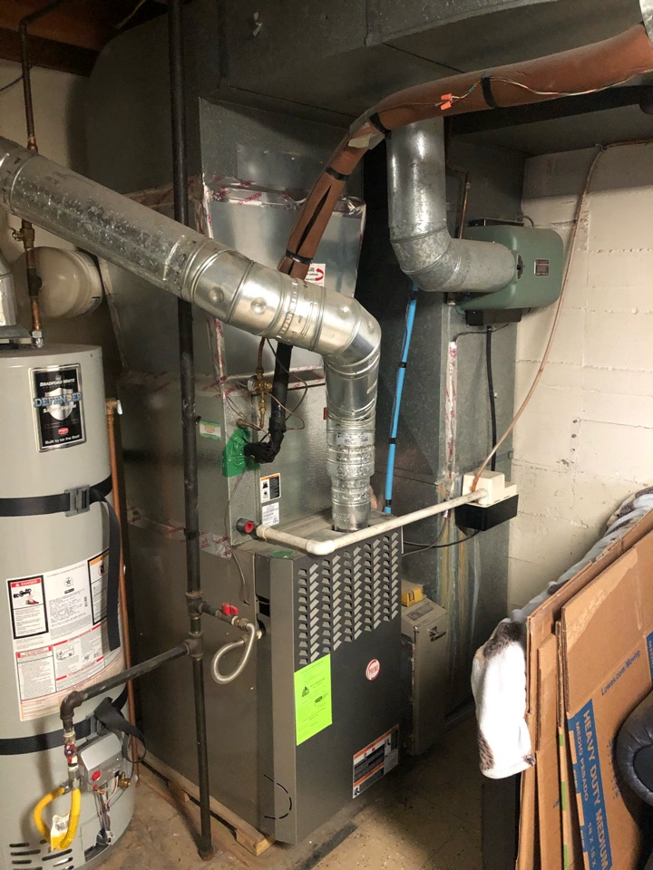 Salt Lake City, UT - Giving a free estimate to replace a 16 year old Bryant furnace and a/c.