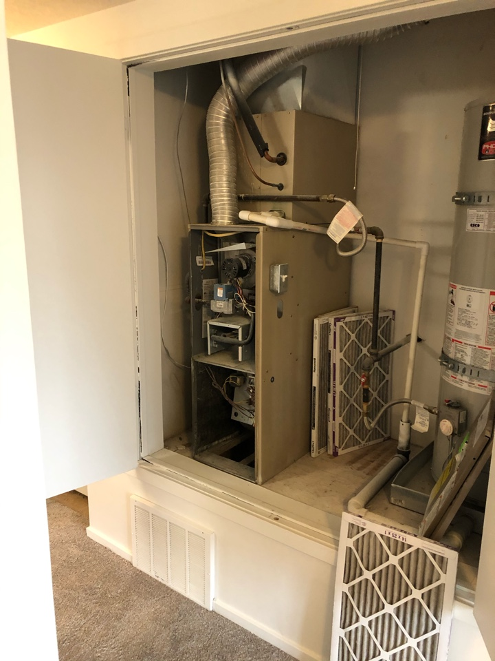 Millcreek, UT - Giving an estimate to replace the 19 year old Armstrong furnace and a/c with new equipment. It's a little limiting what can be done with a condo complex like this but they still have a lot of options to consider.