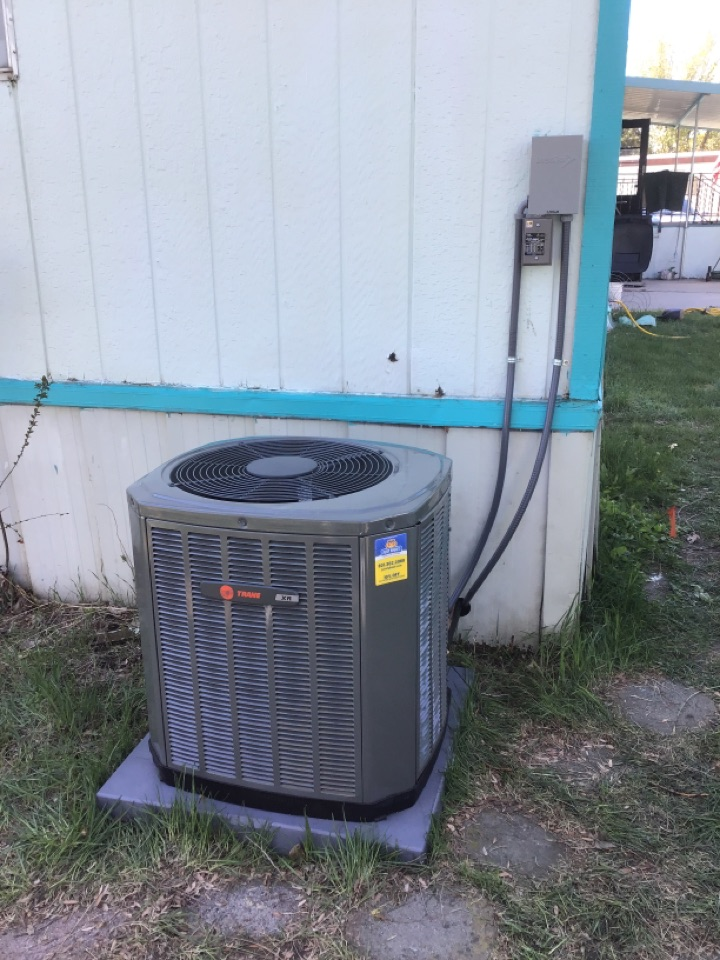 Riverdale, UT - Brand new Trane XR air conditioning unit with surge protector.