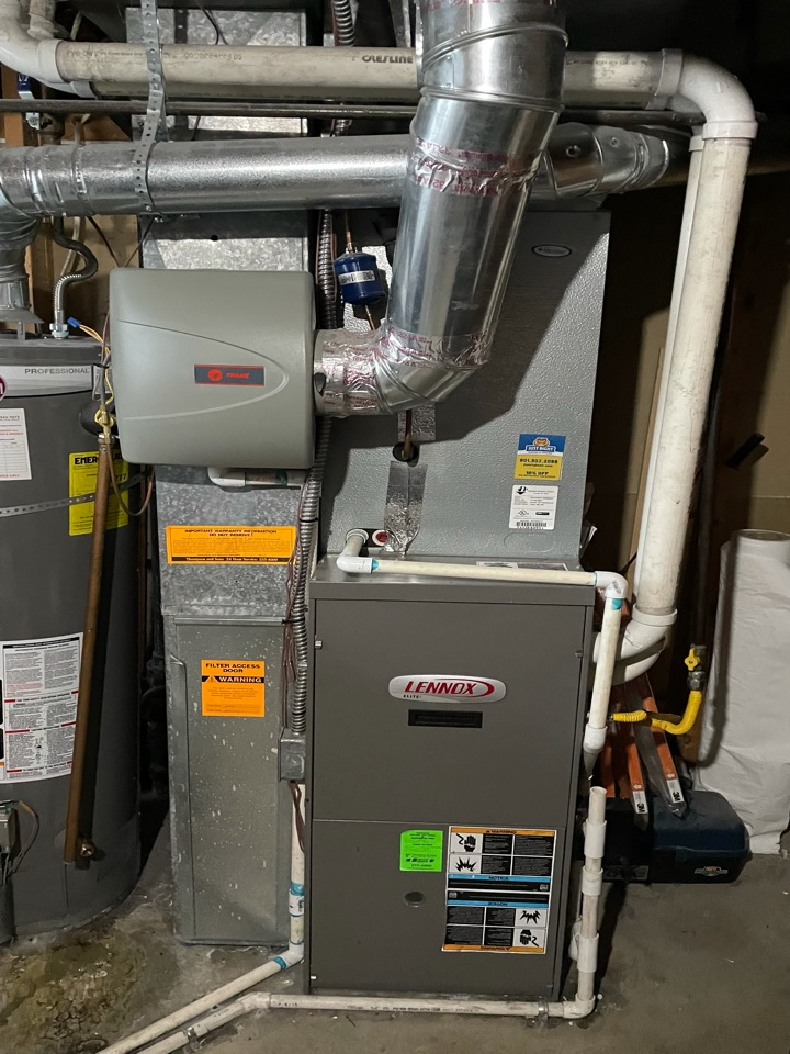 Kearns, UT - Giving an estimate to replace a 16 year old Lennox furnace.