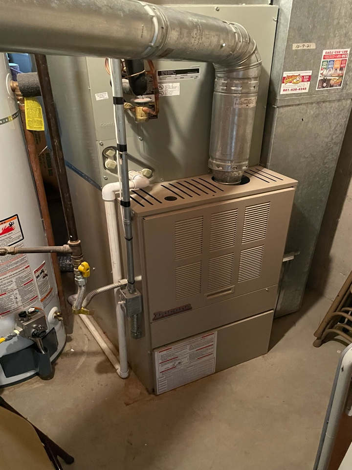 Taylorsville, UT - Giving an estimate to replace a 20 year old Ducane furnace with a new high efficient furnace.