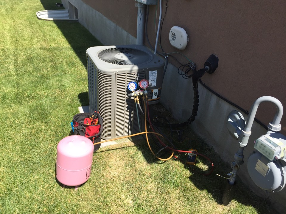 Woods Cross, UT - Added refrigerant to air conditioner.
