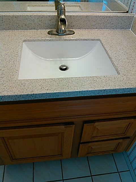 Torrance, CA - Installed new cultured lavatory sink,new faucet,angle stops,supply lines,toilet flange,Santee in the wall,p trap,trap arm.