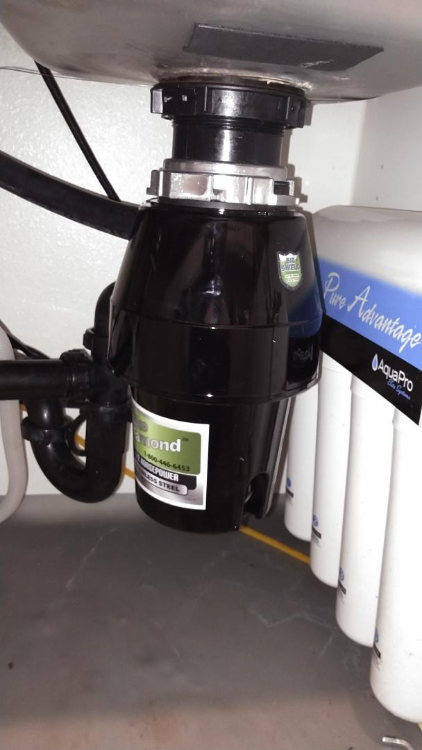 Santa Clarita, CA - Install new garbage disposal under kitchen sink.