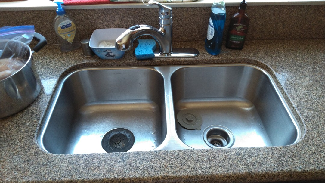 Cleared out kitchen sink stoppage from exterior clean out