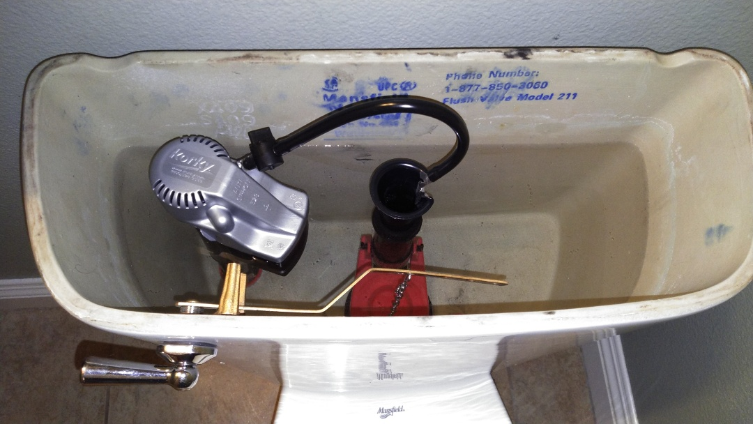 Ontario, CA - Rebuild toilet tank parts with new trip lever and tank to bowl kit