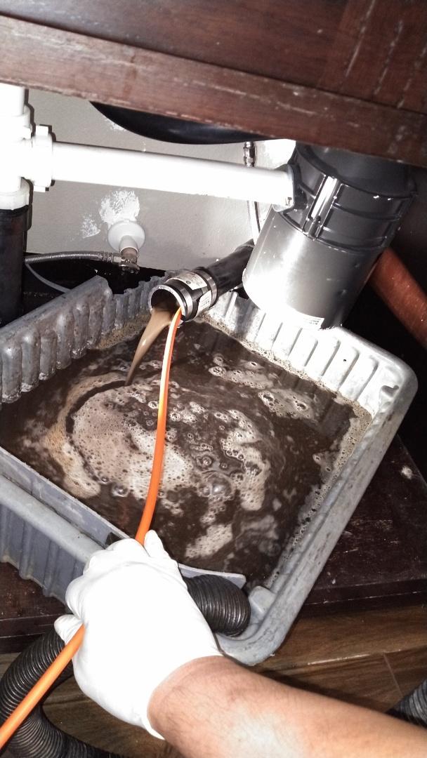 Corona, CA - Kitchen sink stoppage hydro jet under sink