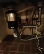 Ran top snake to clear stoppage and reset garbage disposal