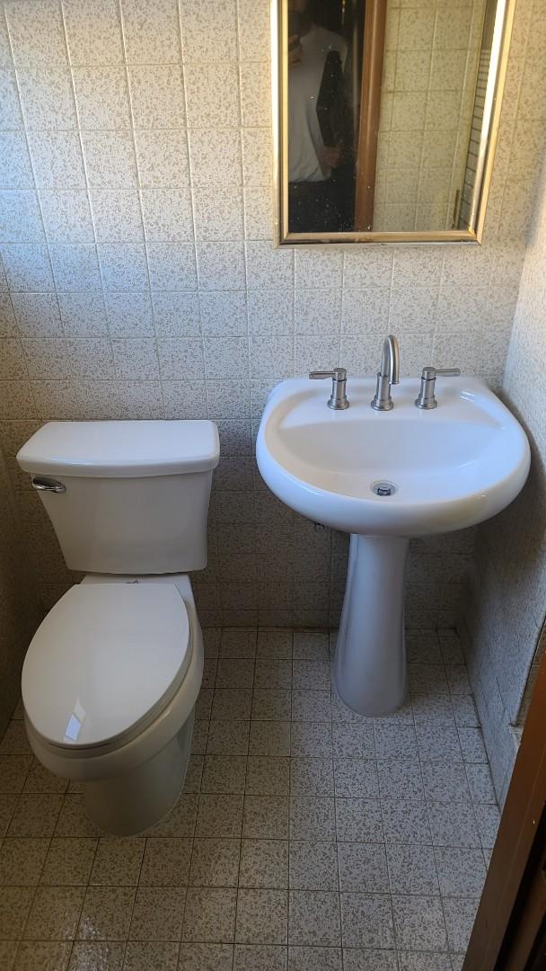 Santa Fe Springs, CA - Installed customer supplied toilet and pedestal sink.
