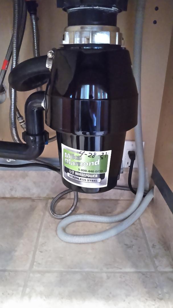 Install new garage disposal under kitchen sink.