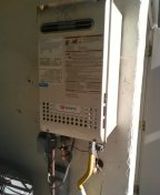 Flush out tankless hot water heater