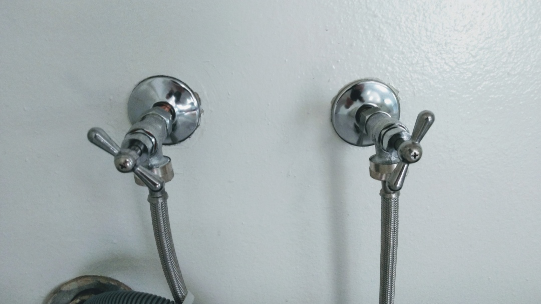 Install new hot and cold shut off valves at laundry.
