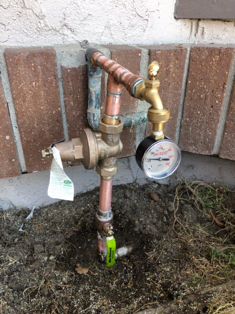 Tech replaced pressure regulator valve and ball valve