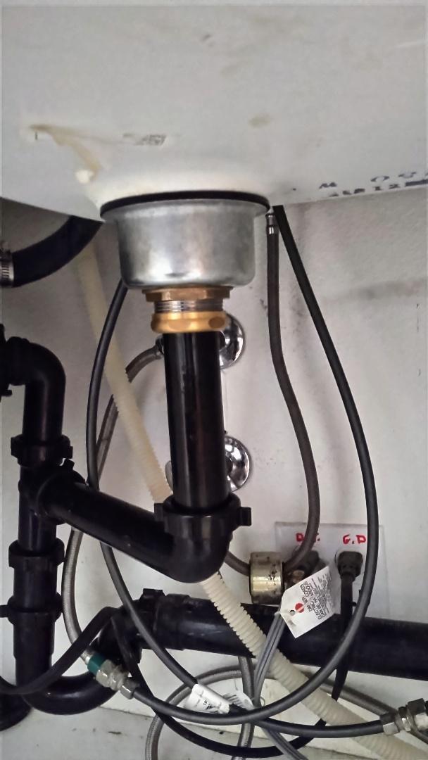 Install new basket strainer under kitchen sink.