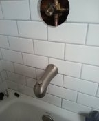 Re installed shower valve and replaced galvanized diverter spout line.