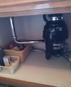 Installed new disposal, installed receptacle with plate.