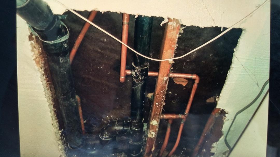 Repair water line and new drain line.