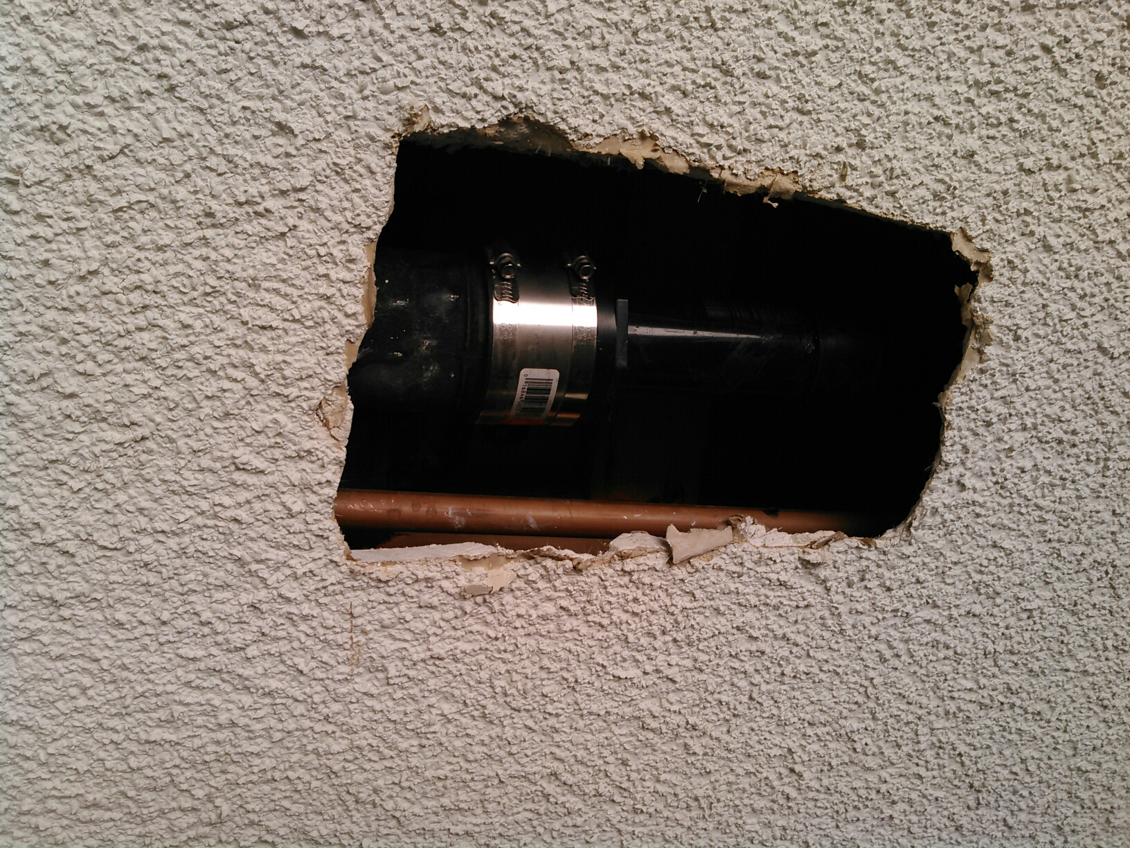 "Tujunga, CA - Replace leaking section of 3"" X 2"" drain in the garage ceiling."