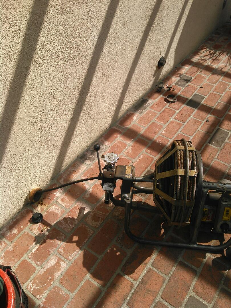 San Marino, CA - Unclogged secondary drain stoppage with cable through a 2 inch clean out access