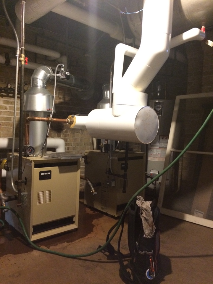 Fort Atkinson, WI - Too much pressure!  Water on the floor from these two Weil-McLain boilers. The expansion tank was full and needed be drained out.