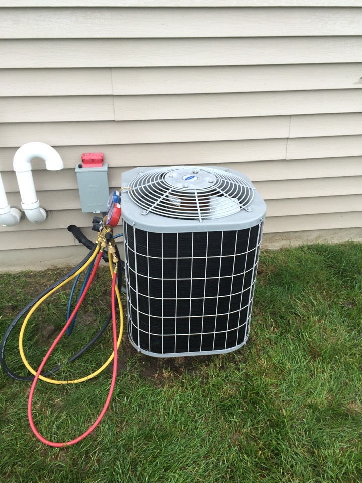 Ixonia, WI - Precision tune up on the Carrier air conditioner per  service agreement