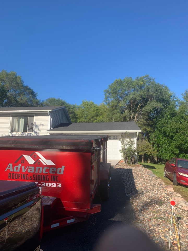 """Ramsey, MN - Major surgery to this garage roof yesterday. Middle 16 trusses were sagged up to 3"""". Myself and my crew spent several hours on this 8sq roof to make as close to flat as possible without costing the homeowner a small fortune. At Advanced we go above and beyond on a daily basis. MASTER ELITE ROOFING CONTRACTOR."""