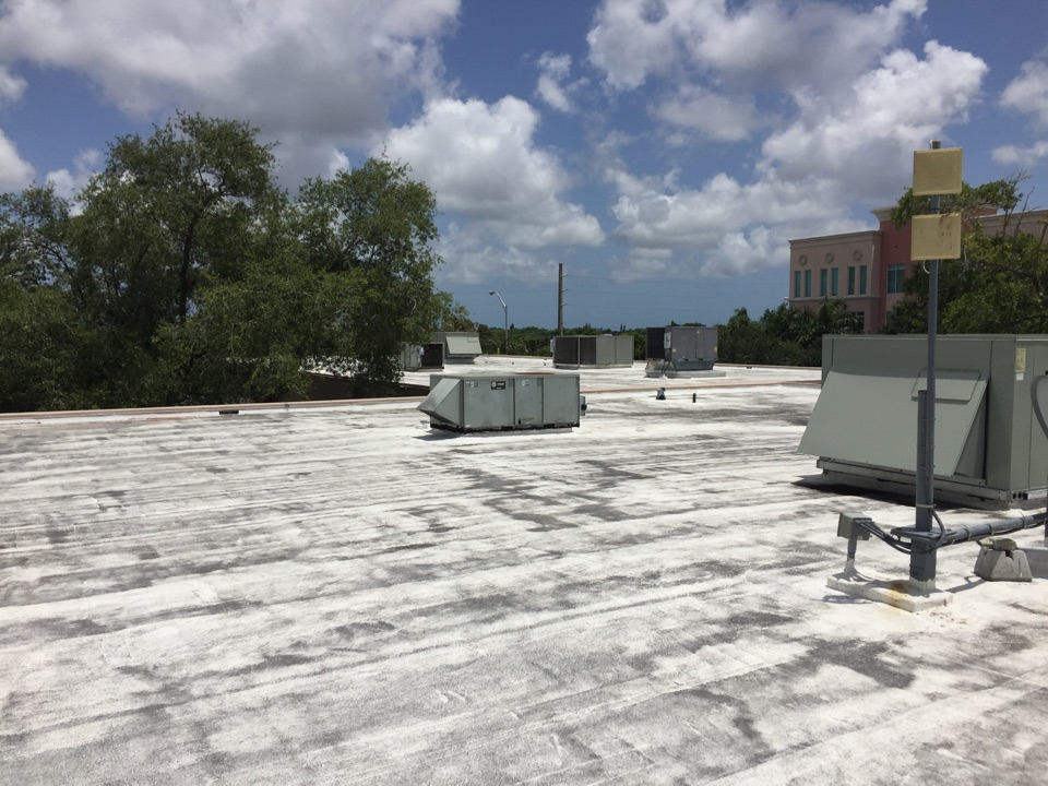 Kendall, FL - Installing surge protectors on 13 roof top units