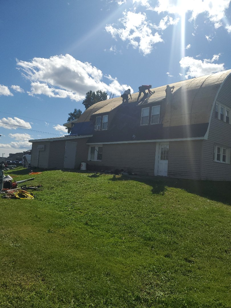 Tunkhannock, PA - Day 1  Using GAF Timberline Hunter Green shingles on an apartment complex in Tunkhannock.