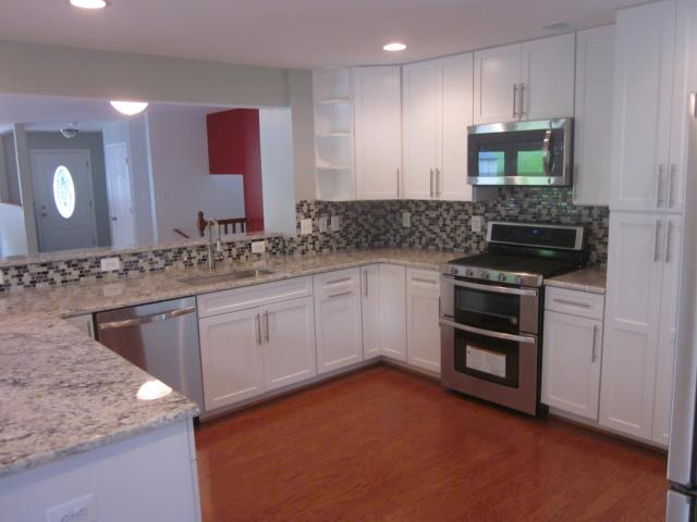 Springfield, VA - A beautiful new kitchen is the focal point of the new open floor plan. This homes transformation from a property badly damaged by fire to a completely restored, renovated and updated home is now complete.