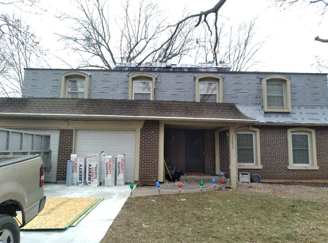 Shawnee, KS - We are installing the most excellent GAF HDZ roofing system and new maintenance free gutter system in Shawnee, Kansas! It's going to look awesome!