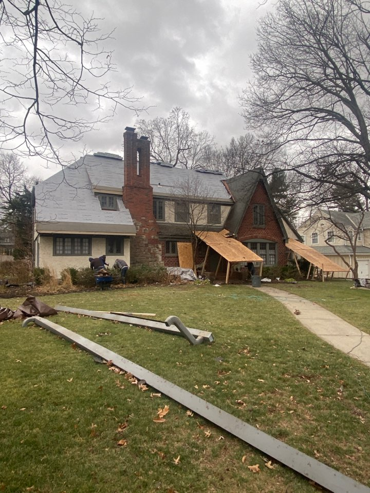 Kansas City, MO - Removed three layers of shingles. Removed 6 inch gutters and built platform to protect home and landscaping.