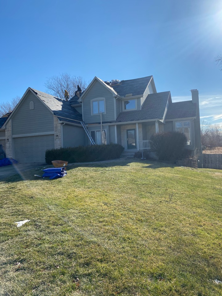 Belton, MO - Removing one layer of timberline shingles. Installing synthetic underlayment to the roof and reapplying GAF HDZ Weathered wood colored shingles. Removing gutters and installing 5 inch seamless Aluminum gutters with 3x4 inch large downspouts .