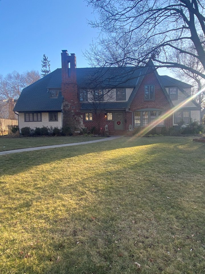 Kansas City, MO - Picking up remaining shingles on a job done perfectly by the crew. What a beautiful home!!!