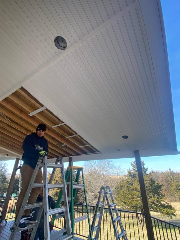 Olathe, KS - Installing vinyl soffit over a new back deck. Looks really good!