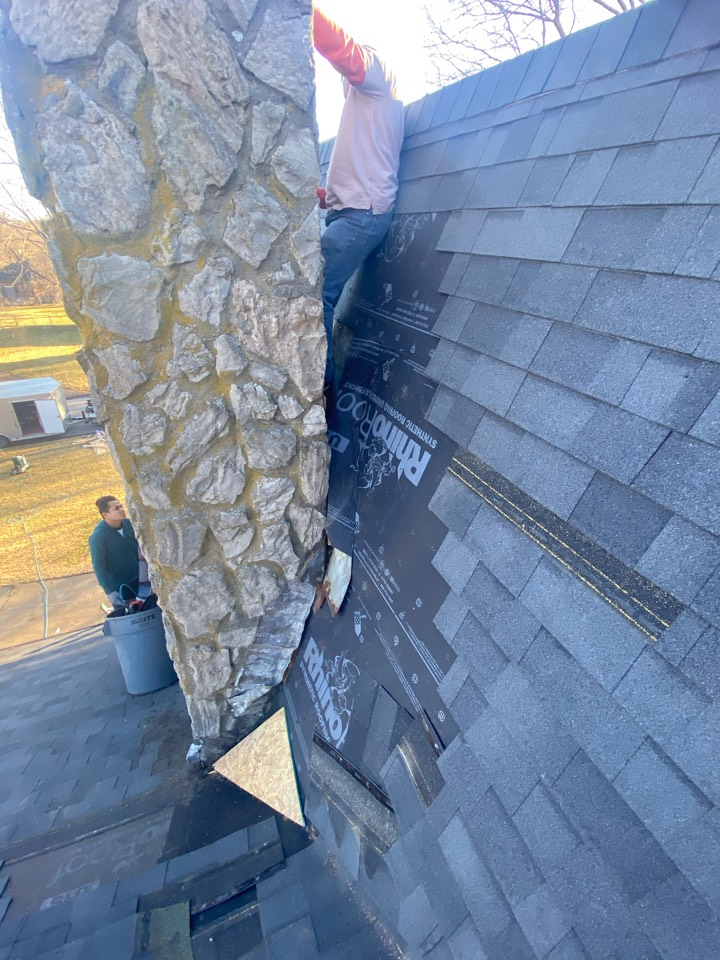 Kansas City, MO - Adding a pan and re-flashing a beautiful old  stone chimney that just wouldn't stop leaking.
