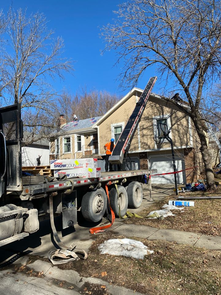 Olathe, KS - Roof is tore off, getting loaded with new shingles.  The synthetic underlayment and ice and water shield is on and this home will go from having one of the ugliest roofs on the block, to the best looking one. With our amazing roofing system and great workmanship this roof will now stand apart from the others.