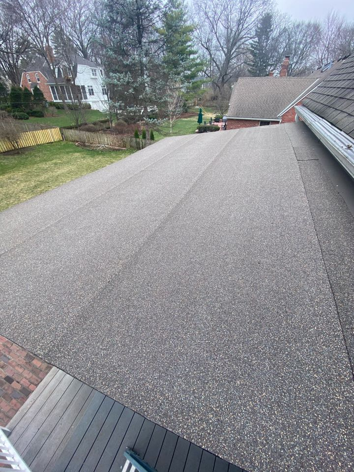 Prairie Village, KS - Picking up check after replacing a couple sheets of plywood and redoing the back porch roof with Liberty plan with base sheet.  Customer was very pleased with the product and with our workmanship.