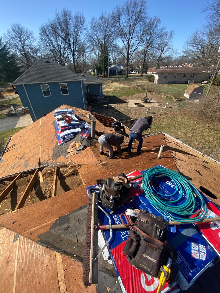 Kansas City, MO - Removing  one layer of shingles on a older roof and replacing about  20 sheets of plywood with solid OSB decking.  Color of this roof will be Bark Wood. We are also putting in metal gutter screens.  I'm excited for the home owner and I can't wait for them to see it when it's done.