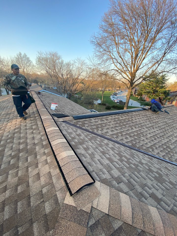 Kansas City, MO - Installing GAF Snow country ridge vent and wrapping it up.