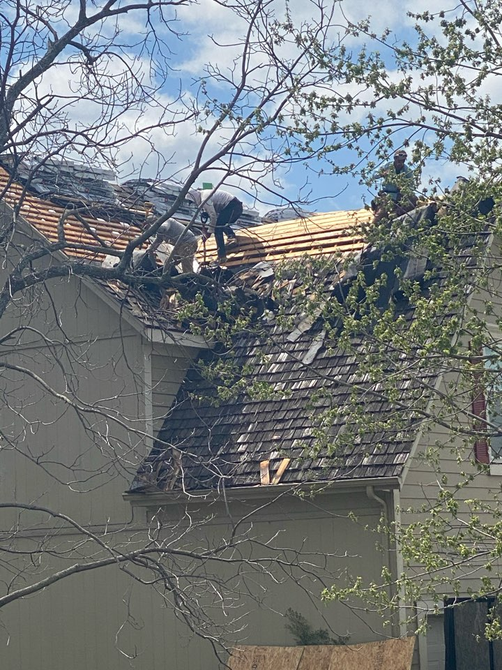 Olathe, KS - Tearing off old Shake shingles. Installing new OSB and GAF Timberline  ULTRAS Making this up to date with the H.O.A. This roof is going to look absolutely amazing.